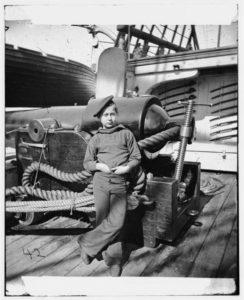 Powder monkey by gun of U.S.S. New Hampshire off Charleston
