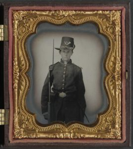 Unidentified young soldier in Union infantry uniform with Hardee hat and musket.