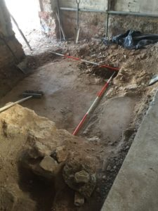 Remains of an old building have been discovered beneath the Newton's Place museum and community space project in Newton Abbot