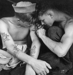 A tattooed sailor aboard the USS New Jersey, 1944.