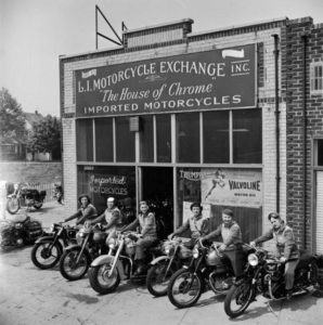 A group of women dubbed the 'Motor Maids of America' sit astride their motorcycles outside the shop they use as their headquarters.