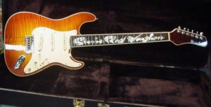 Signed Stevie Ray Vaughan reproduction guitar.