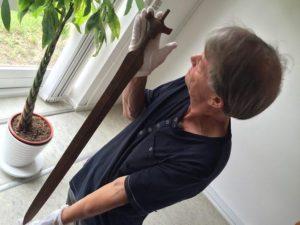 Arne Hedegaard Andersen holds Bronze Age sword.
