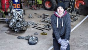 Daniel Kristensen with debris from the wreck of the World War Two aircraft