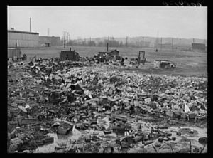 City dump. Dubuque, Iowa. In the background, there are shacks occupied by men who salvage anything marketable in the dump.