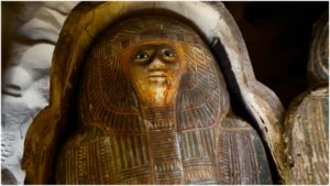 A colorful wooden coffin cover was found inside a newly discovered ancient limestone tomb of two priests from Egypt's Fifth Dynasty (about 2500 BC) near the Pyramids of Giza.
