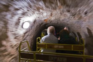 people travel by entertainment train in Postojna Cave.