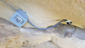 The live-streaming condor-cam is mounted on the ceiling of a wild California condor nest in remote Pole Canyon.
