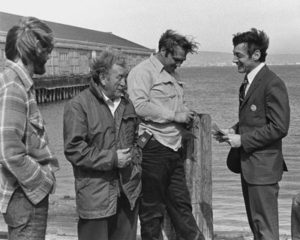By the time of Milk's 1975 campaign, he had decided to cut his hair and wear suits. Here, Milk (far right) is campaigning with longshoremen in San Francisco during his 1976 race for the California State Assembly.