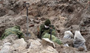 Belarus military at the dig site.