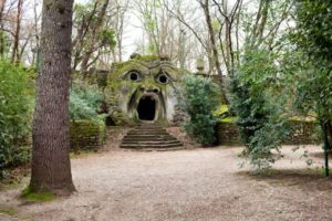 The Ogre or Orcus Mouth is the most famous statue in The Park of the Monsters (Sacred Grove) of Bomarzo. Is a huge head of a man petrified by a shout.