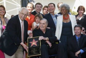 James Doohan (seated) receives the 2,261st star on the Hollywood Walk of Fame surrounded by the original Star Trek cast.