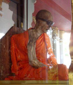 Luang Phor Daeng Payasilo, the mumified monk, at Wat Khunaram, Ko Samui, southern Thailand.