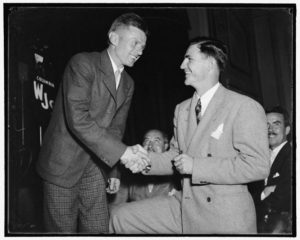 "Doug ""Wrong Way"" Corrigan greets Sammy Baugh, Ace Passer of the Washington Redskins, at a reception at the National Press Club, 1938"
