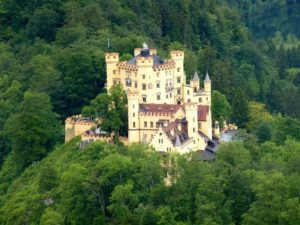 view of Neuschwanstein Castle near Hohenschwangau, Germany during spring afternoon surrounded by spring colours.