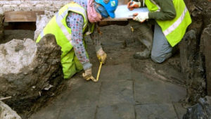 Experts uncovering a 2,000-year-old Roman tiled floor