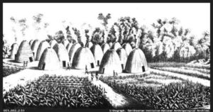 A sketch of a Wichita Indian village in the 19th century. The beehive shaped grass-thatched houses surrounded by corn fields are characteristic and appear similar to those described by Coronado in 1541.