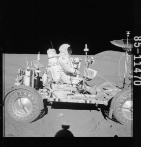Astronauts driving on the Moon.