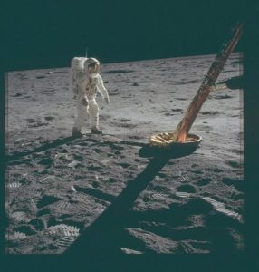 The first photograph was taken by Neil Armstrong on the surface of the Moon, 1969.