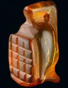 An amber amulet in the shape of a gladiator's helmet was discovered