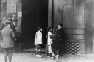 Children gather on a street in Chinatown. In the late 1880s, Chinese kids were denied access to public schools.