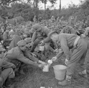 The British Army in Normandy 1944 – Tea is being served to German prisoners in the Falaise pocket, Aug. 22, 1944.