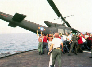 RVNAF-Huey-is-pushed-overboard-from-USS-Midway.