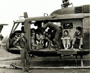 VNAF Huey full with evacuees on the deck of the USS Midway.