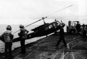 sVNAF_Huey_is_pushed_over_the_side_of_USS_Hancock_(CVA-19)_1975.