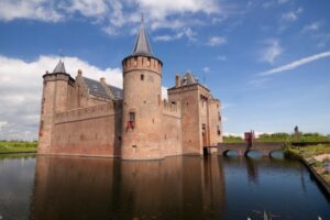 Muiderslot in the Netherlands looks almost unreachable thanks to its water-filled moat.