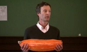 Brian Etkin holds the ancient squash