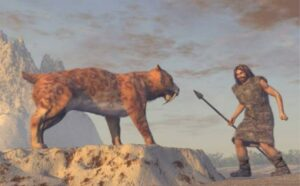 Stone Age man and saber-tooth cat.