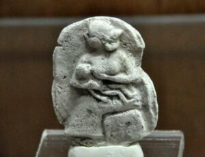 Relic from Mesopotamia (2000-1500 BC) at The Sulaimaniya Museum, Iraq, shows a woman breastfeeding her child.
