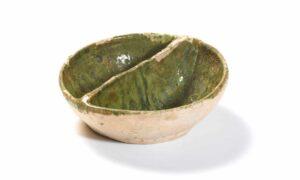 A 14th-15th century 'coarse border ware' condiment dish with copper green glaze.