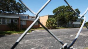 A cemetery was once located in this parking lot next to a vacant Pinellas County School District building in Clearwater. Now ground radar has discovered 44 African-American graves at the site, and more could be found.