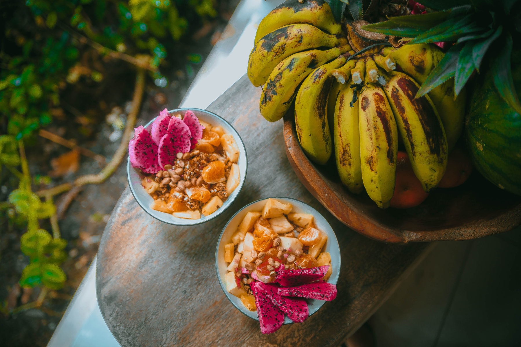 bali friends enjoying life and fresh fruit by the pool while on holidays in indonesia granola healthy vegan food fresh fruit