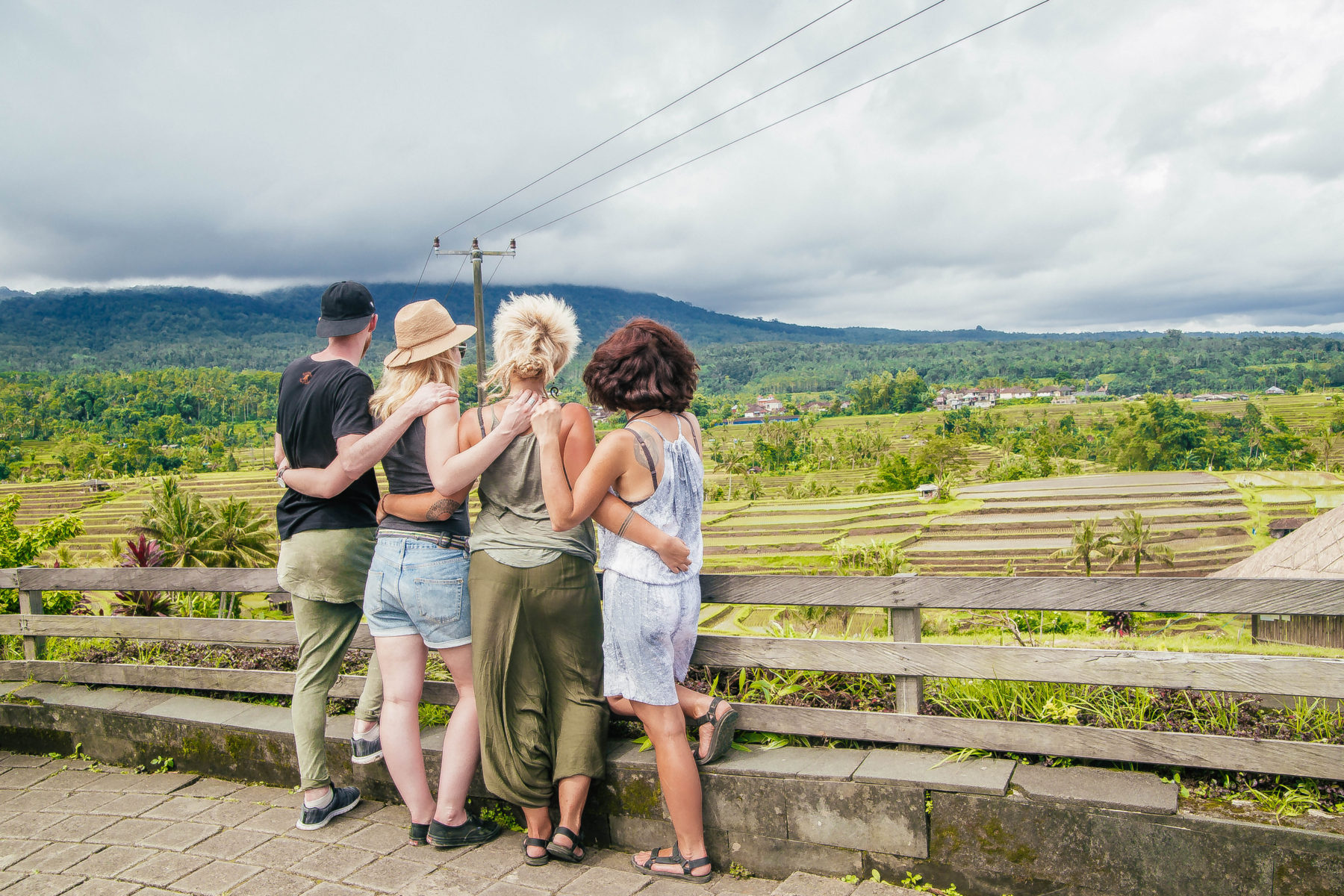 bali explore indonesia friends together standing next to rice fields trip travel