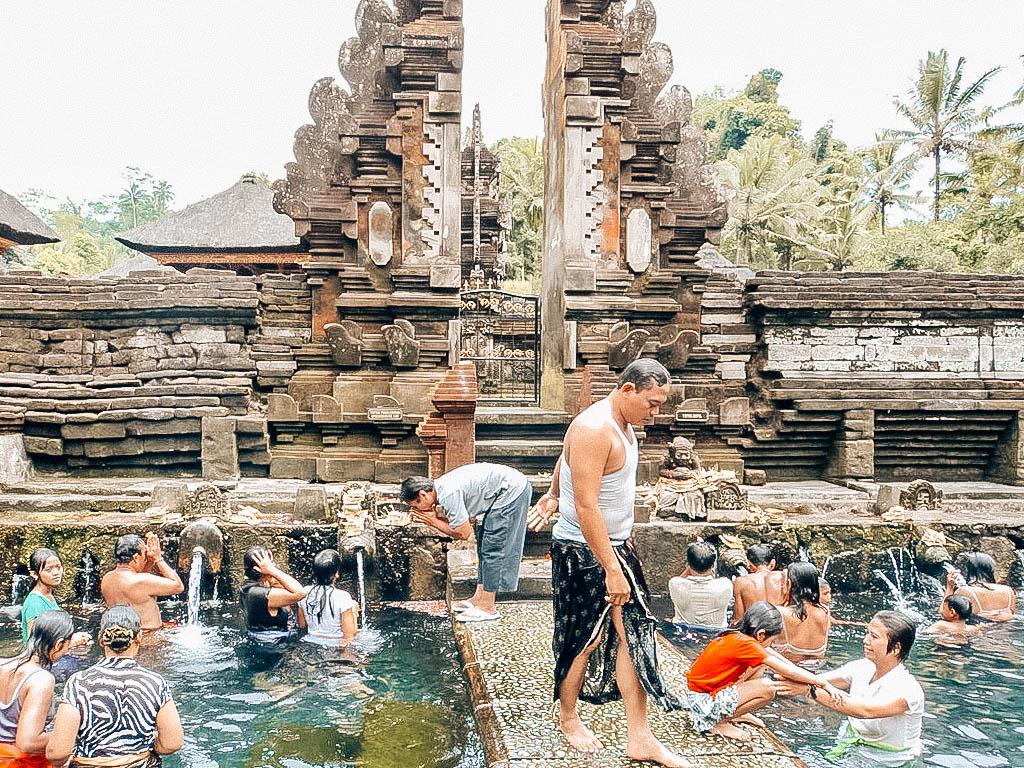 bali temple indonesia hindu gate clouds mount angung volcano view friends