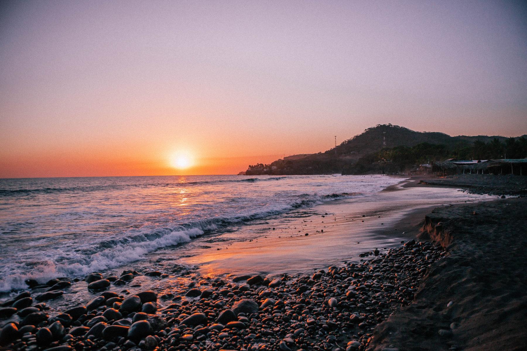 el salvador el tunco surf beach town sunset bright colours stones pacific coast