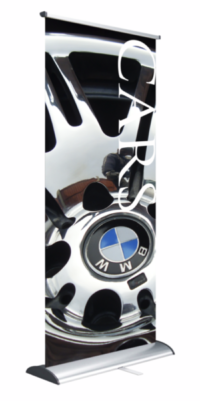 Roller banners by BigPrint. Showing a custom graphic of a BMW alloy/wheel