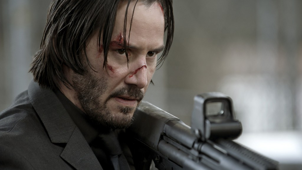 Keanu reeves , a still from john wick series - cinema roundup