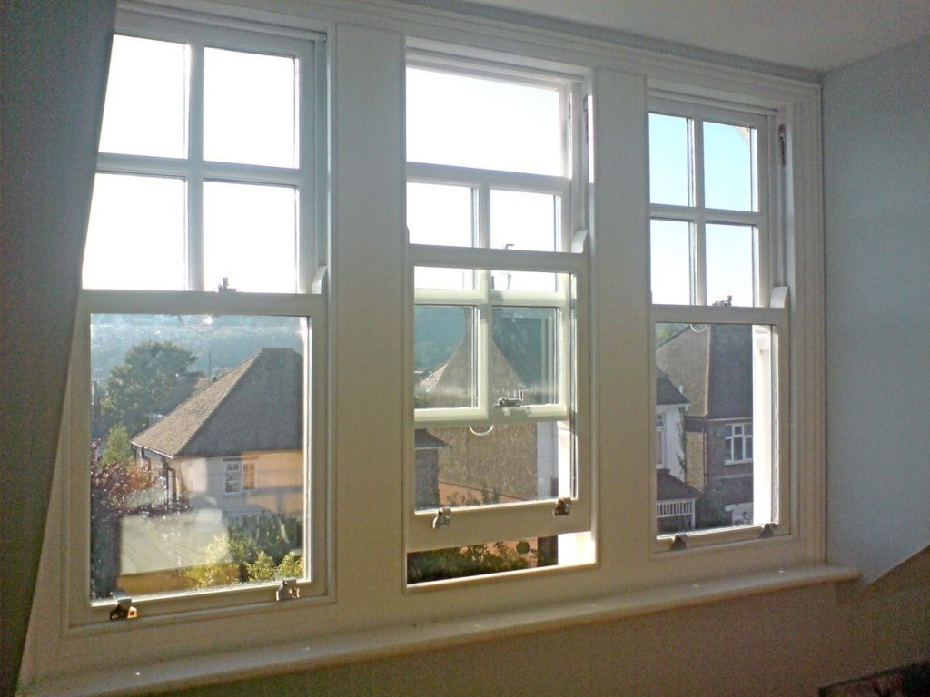 Picture of three sash windows taken from the interior looking out.