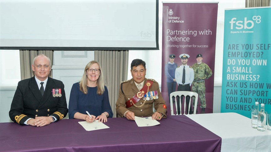 Debbie Scott, co-founder and director of Scott Communications, signing the Armed Forces Covenant