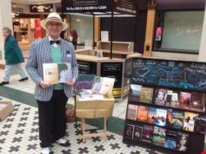 Photo of author Kevin Marsh in front of Pop Up Booktique in Camberley