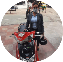 customer with her electric scooter on rent in gurgaon