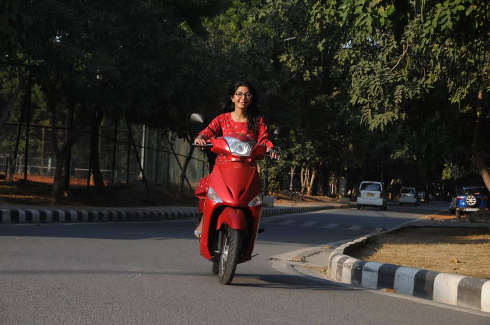Girl on electric scooter on rent