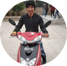 customer on his rented electric scooter in delhi