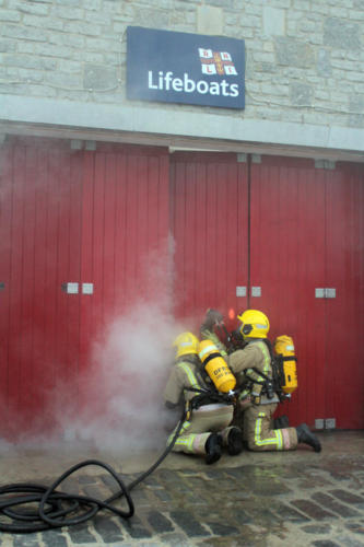 The fire crew carry out an exercise at the lifeboat station