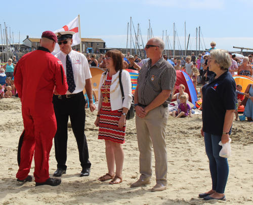The Red Devils are greeted by Ian Marshal of Lyme Regis lifeboat crew; mayor Michaela Ellis and her husband Alan; and Anna Driver, who jumped with them earlier this year in ad of the Royal British Legion
