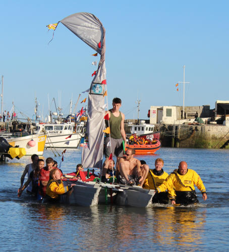 Lifeboat crew members held the Alexandra Hotel team complete the race